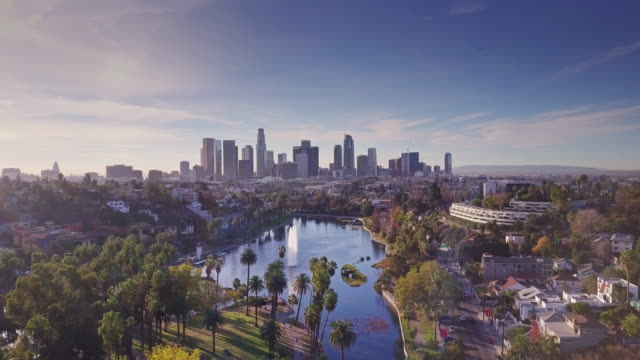 echo park and its lake - aerial shot - los angeles стоковые видео и кадры b-roll