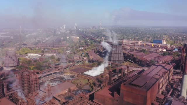 Ecological catastrophy. Aerial view of blast furnaces and cooling towers Ecological catastrophy. Aerial view of blast furnaces and cooling towers. Smog in the city. metallurgy stock videos & royalty-free footage