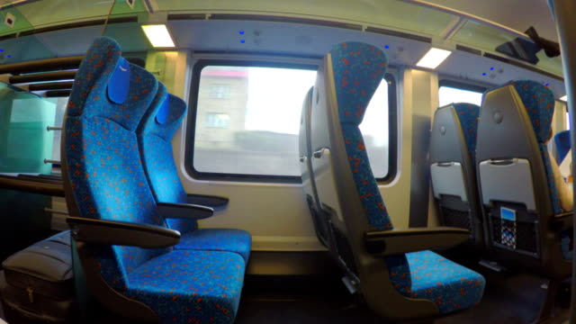 Economy class train with many empty seats moving, no passengers video