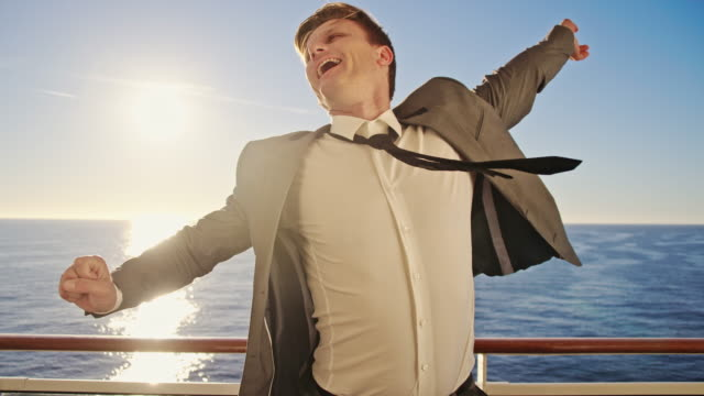 SLO MO Ecstatic businessman on a ship video