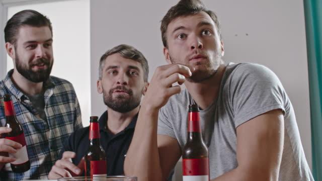 Ecstatic Male Friends Celebrating Goal video
