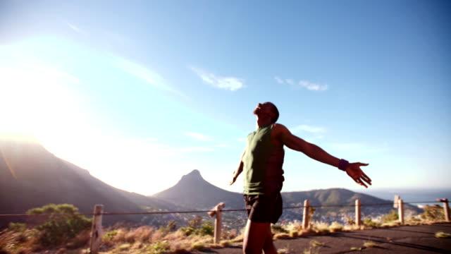 Ecstatic runner enjoying a morning fitness exercise video