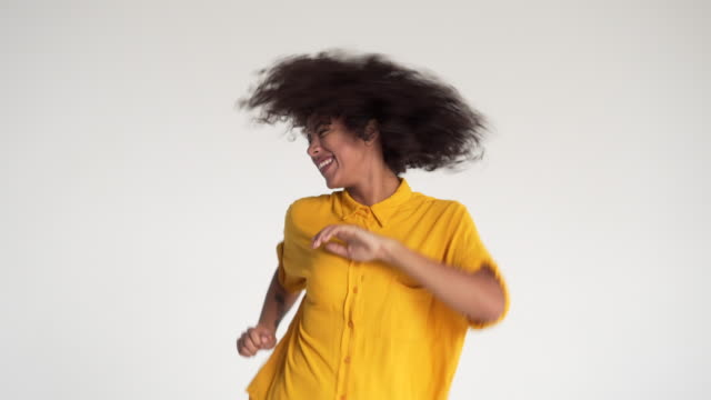 Ecstatic woman dancing and celebrating success Ecstatic african american woman dancing and giving thumbs up gesture bolos stock videos & royalty-free footage