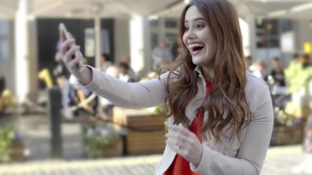 ecstatic young woman, phone celebration joy.. - lotteria video stock e b–roll