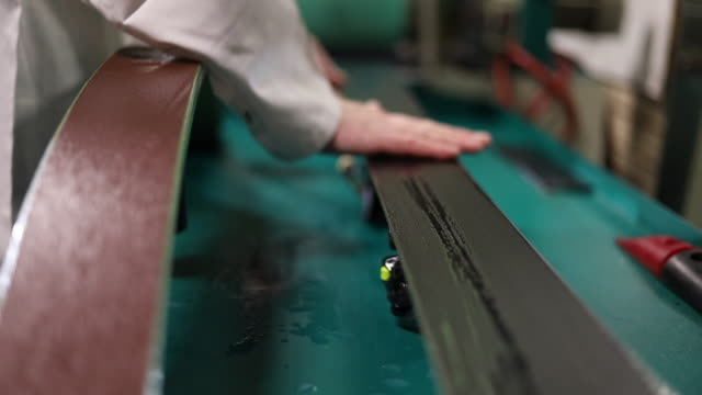 edge and base adjustment in ski rental and repair shop in various stages of production series - negozio sci video stock e b–roll