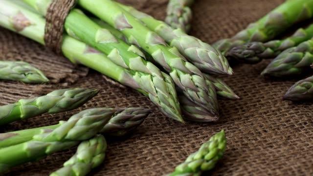 Edible green sprouts of asparagus officinalis. Raw garden asparagus stems. video