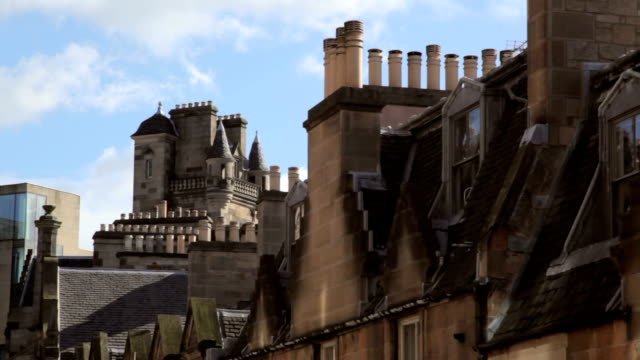 Edinburgh City Centre skyline with modern and traditional architecture Two shots of Edinburgh city centre rooftops showing modern and heritage architecture, with chimney pots. victorian architecture stock videos & royalty-free footage