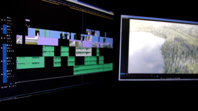 コンピューターでビデオの編集や色補正 - 編集者点の映像素材/bロール