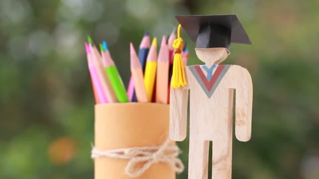 education learning concept, university knowledge achievement for study abroad international, alternative studying idea. Models graduation celebration pencils box and radar background, Back to School.