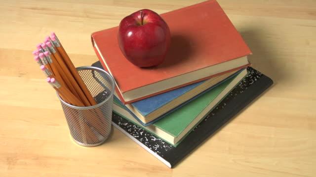 education still life - school supplies stock videos and b-roll footage