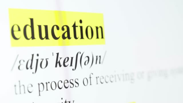 Education Text Macro Shot Highlighted in Yellow Color On Computer Screen