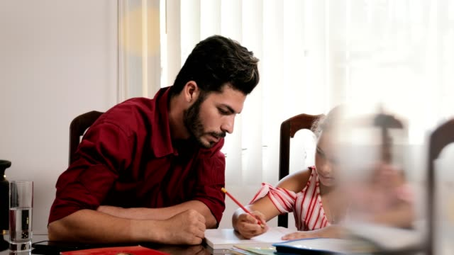 Education With Dad Helping Daughter Doing School Homework At Home video