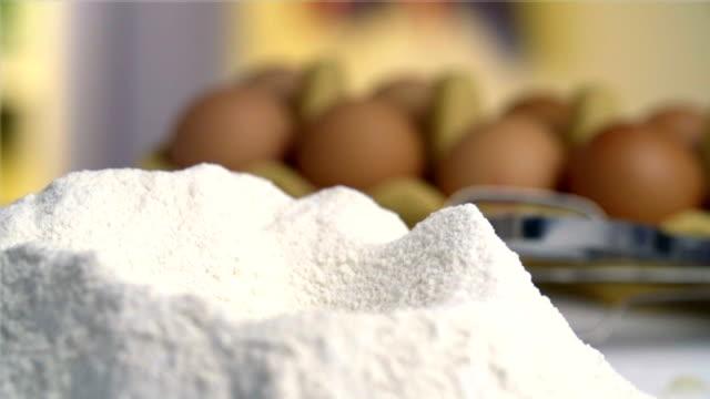 Egg falling into flour video