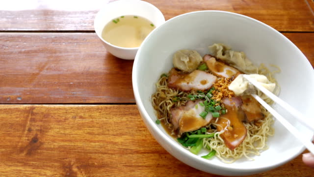 Egg noodle with roasted pork bowl. video