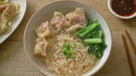 istock egg noodles with pork wonton soup or pork dumplings soup and vegetable - Asian food style 1319567792