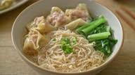 istock egg noodles with pork wonton soup or pork dumplings soup and vegetable - Asian food style 1319721773