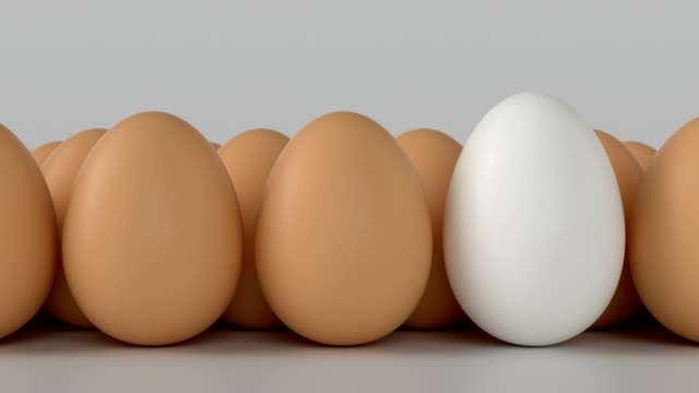 Egg. Symbolizes differences with each other Eggs. Ideal for everything related to healthy food, Easter, egg production and the food industry in General. Symbolizes the differences one with the other. 3D animation 4k Ultra HD 3840x2160 boiled stock videos & royalty-free footage