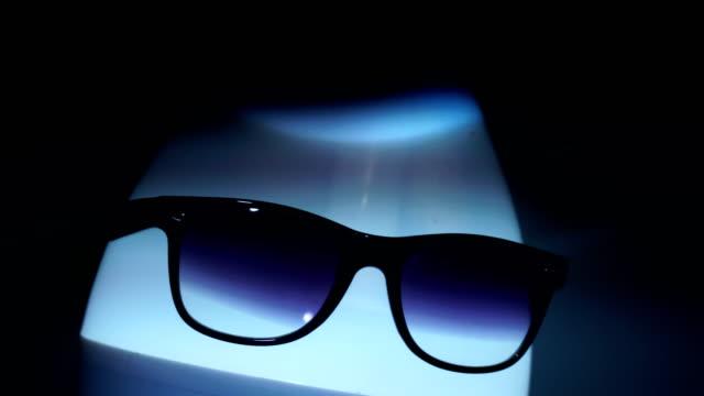 egghead man in sunglasses in stroboscope video