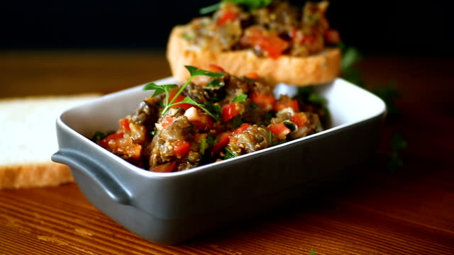 eggplant caviar with tomatoes and a slice of bread - melanzane video stock e b–roll