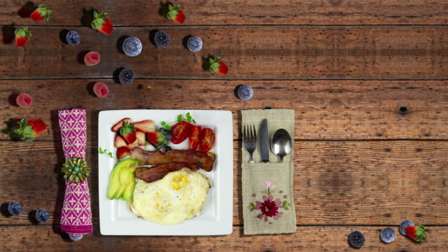 Eggs and Bacon Breakfast Plate on Wooden Table