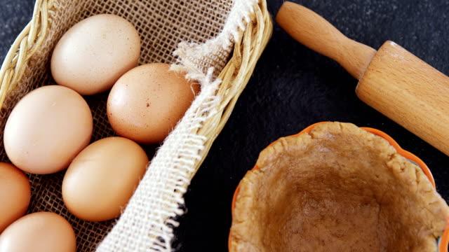 Eggs in wicker basket with dough 4k video
