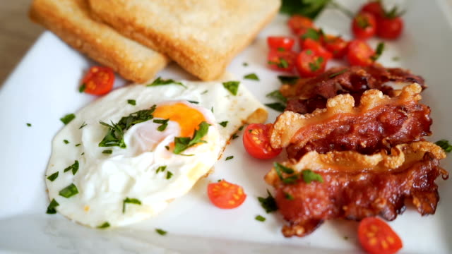 Eggs, toast and bacon for breakfast Eggs, toast and bacon for breakfast bacon stock videos & royalty-free footage