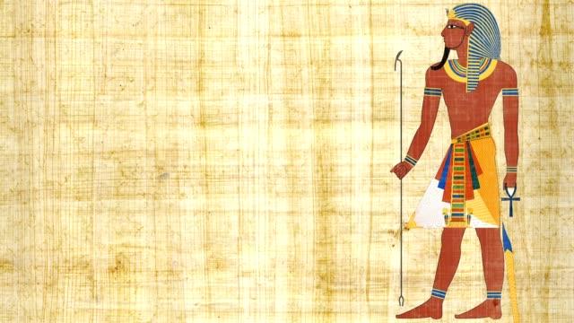 Faraón egipcio sobre un fondo papiro - vídeo