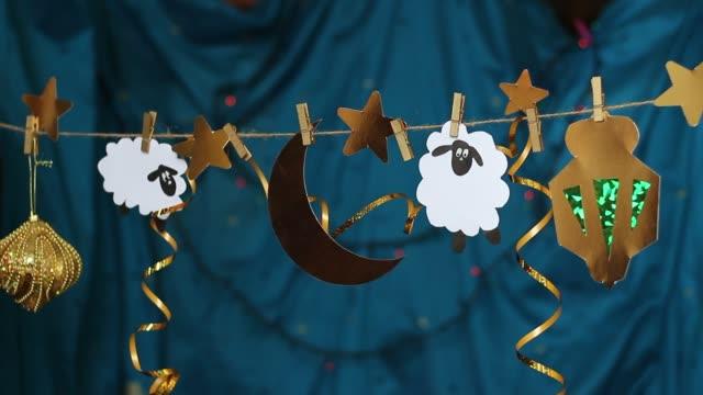 eid al-adha. offra fest. islamiska festivalen - eid ul adha bildbanksvideor och videomaterial från bakom kulisserna