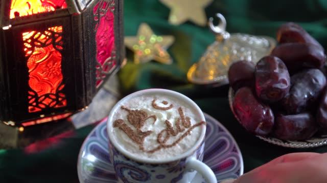 eid-islamisk semester. kaffe stencil. maten av ramadan. kopp kaffe, dadlar, torkad frukt, godis - ramadan lykta bildbanksvideor och videomaterial från bakom kulisserna