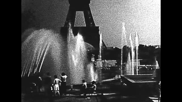 Eiffel Tower fountain Paris Eiffel Tower with fountain from Palais de Chaillot palace. Jardins du Trocadero gardens with tourists. Historic BW archival footage from 1960 in France. 20th century stock videos & royalty-free footage