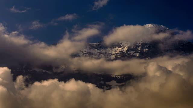 Eiger North face and Mittelegi ridge clouds gathering video