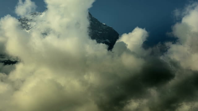 Eiger North face being covered in clouds time lapse video