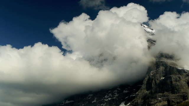 Eiger North Face - Timelapse of flowing clouds video