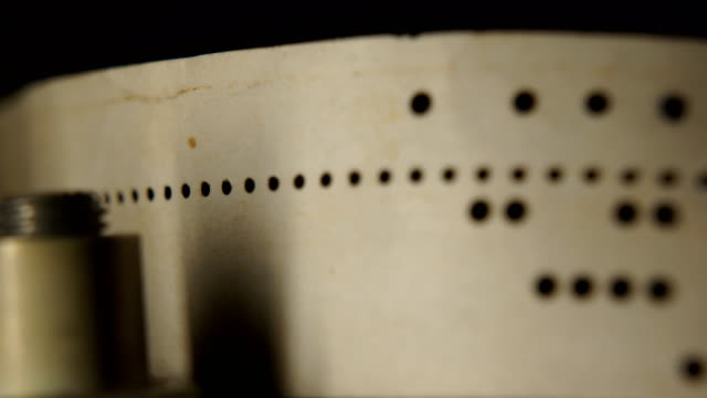 eight-hole punched paper tape eight-hole punched paper tape macro mainframe stock videos & royalty-free footage