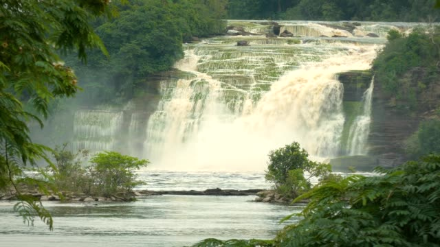 El Hacha waterfall at Canaima National Park Lagoon. Canaima is a world known place for the beauty of nature and countless waterfalls. Canaima is visited for tourist all around the world. video