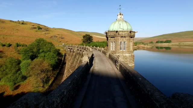 Elan Valley reservoirs, Wales The Craig Goch Dam and reservoir in the Elan Valley, Powys, Wales. Polecam tracking shot. victorian architecture stock videos & royalty-free footage