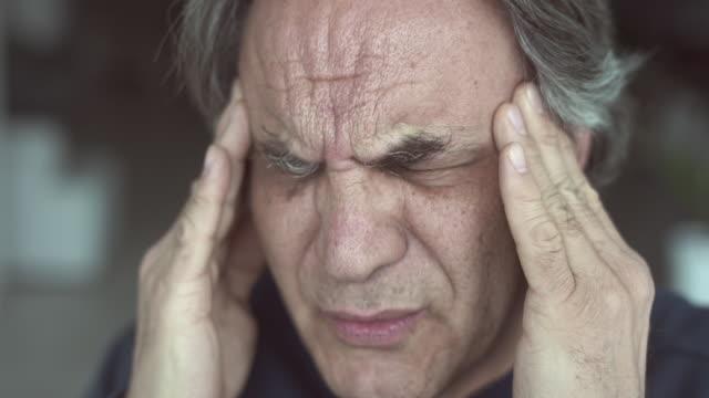 Elder man have a headache video