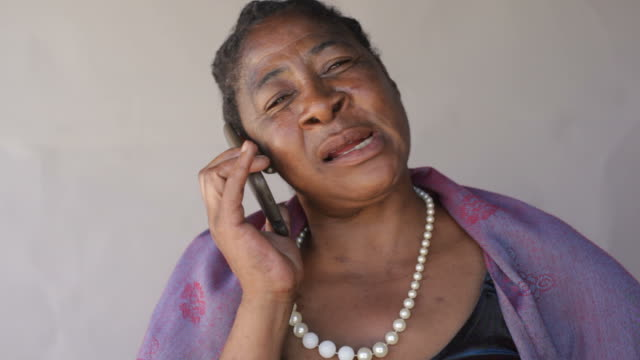 Black woman talking on the phone