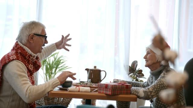 Elderly Couple Christmas Dinner in Cafe video