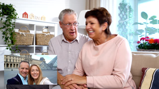 Elderly Couple Connecting with their Adult Children Using Laptop Video Call Camera video