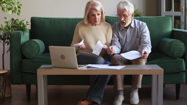 elderly couple managing family budget checking expenses feels anxious - scontrino video stock e b–roll