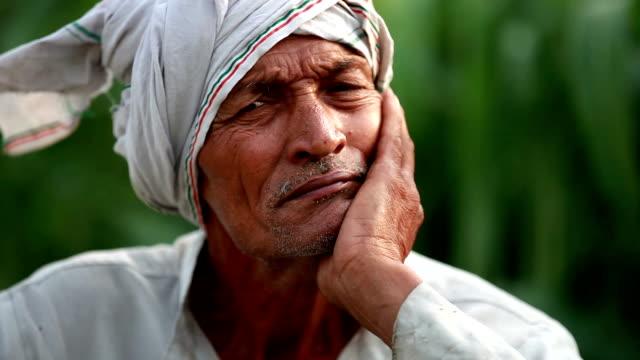 Elderly farmer man lost in thought Elderly farmer man lost in thought very deeply. haryana stock videos & royalty-free footage