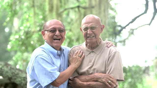 Elderly Hispanic man and adult son in the park video