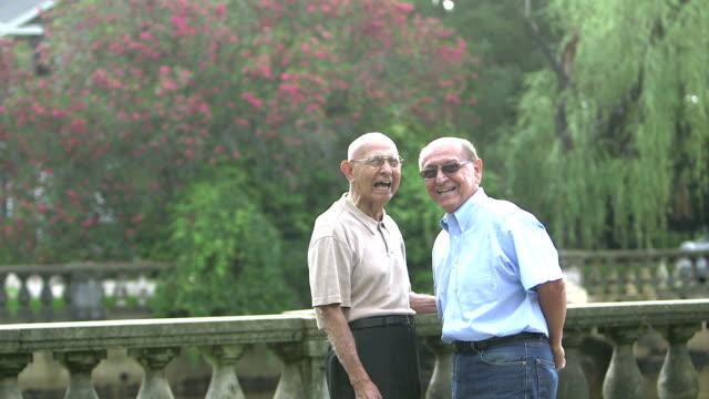 Elderly Hispanic man talking with his son video