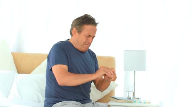 Elderly man having a huge headache video