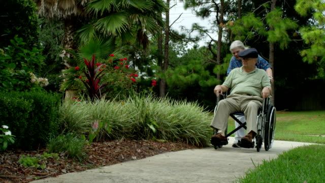 Elderly Man in Wheelchair with Nurse video