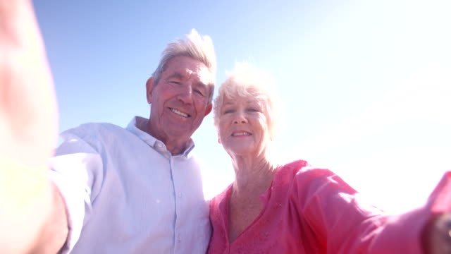 Elderly retired couple taking a self-portrait video