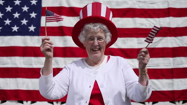 Elderly woman celebrates 4th of July video