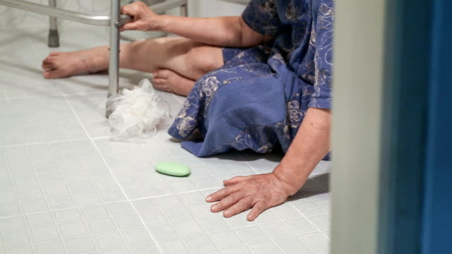 elderly woman falling in bathroom elderly woman falling in bathroom because slippery surfaces fall stock videos & royalty-free footage