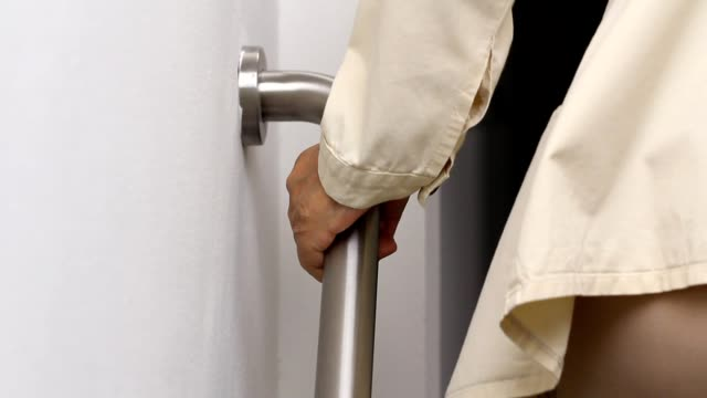 Elderly woman holding on handrail for safety walk steps Elderly woman holding on handrail for safety walk steps railing stock videos & royalty-free footage